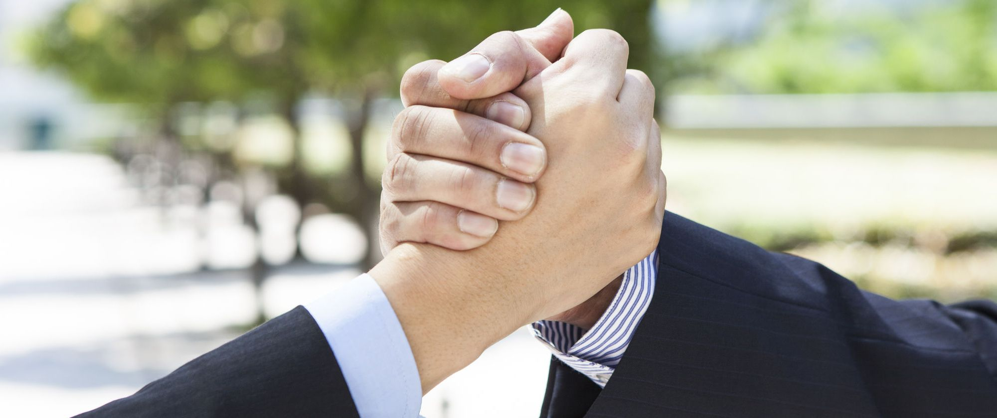 49819413 - business people shaking hands
